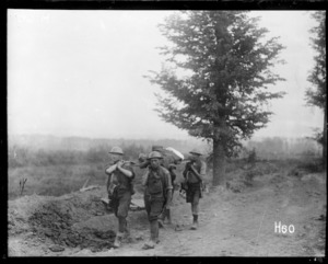 New Zealanders carrying a wounded soldier near Messines, Belgium, during World War 1