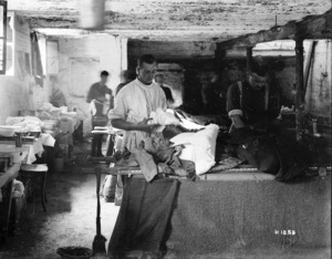 Wounded World War I soldier being cared for at a field hospital