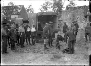 A German medical officer watching the removal of the wounded, World War I