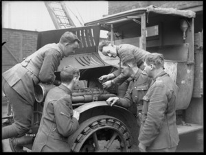New Zealand soldiers receive educational instruction using a German motor car, Mulheim, Germany
