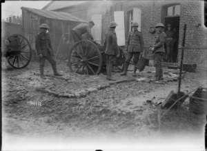 Soldiers stand around a New Zealand field cooker, Solesmes, France