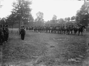 Soldiers of the Otago Mounted Rifles parading past William Massey at Oessy, France