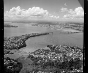 Northcote, North Shore City, featuring Little Shoal Bay and with Waitemata Harbour, Auckland Harbour Bridge, and Auckland City in the background