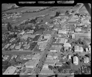 Morrinsville, showing town center including a large hotel, houses, tea rooms, and business premises of Gummer's clothing, The Hamilton Hardware Company Ltd, and Florida Milk Bar